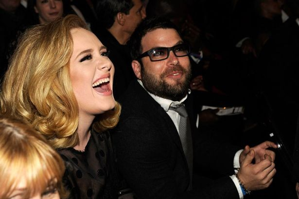 Adele and her husband at an event