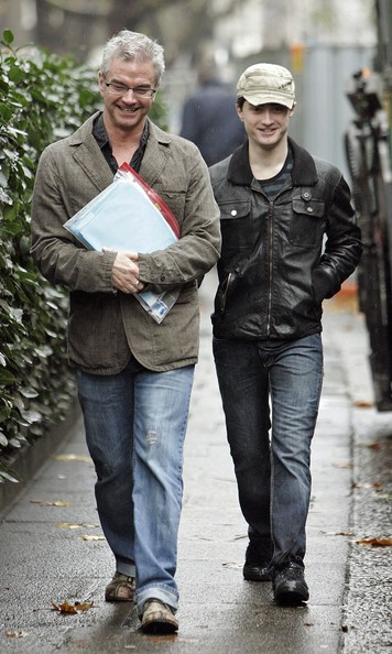 Daniel Radcliffe walking along with his dad