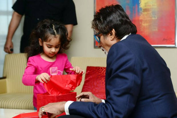 Amitabh giving presents to his grand daughter Aaradhya