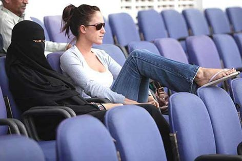 Amal wife watching cricket in stadium