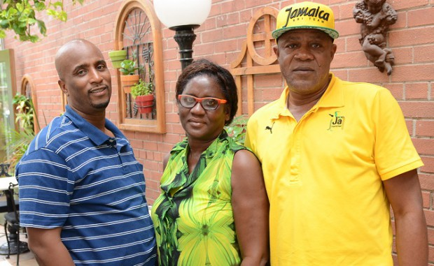 Norman Peart with Usian Bolt's parents