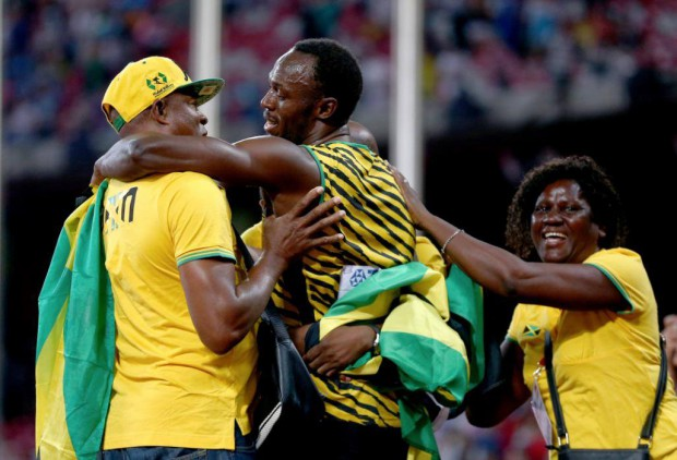 Usain with Mom and Dad in Beijing