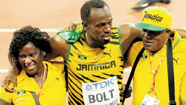 Usain Bolt with his parents