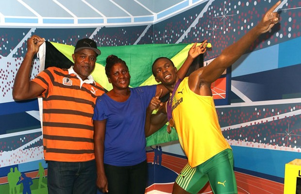 Usain Bolt Parents with their son's wax statue