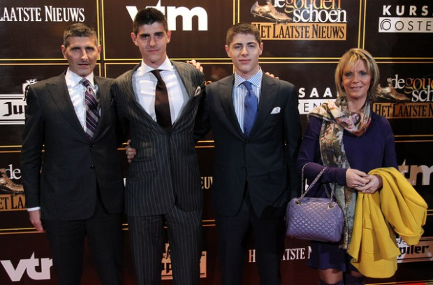 Courtois with his parents and brother