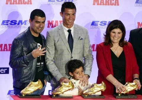 Cristiano Ronaldo with his mom, brother Hugo and son
