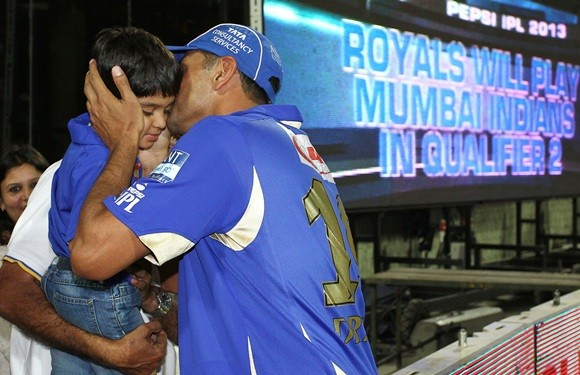 Dravid Kissing his son after winning a match