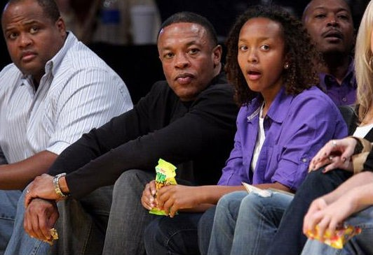 Dr Dre watching Lakers game along with his daughter