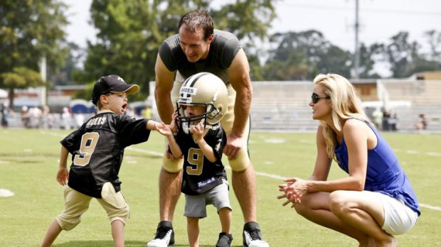 Drew Brees and his wife Brittany with their sons