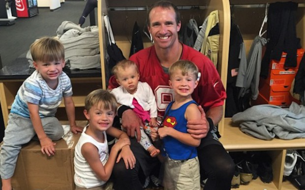 Drew Brees with his kids in dressing room
