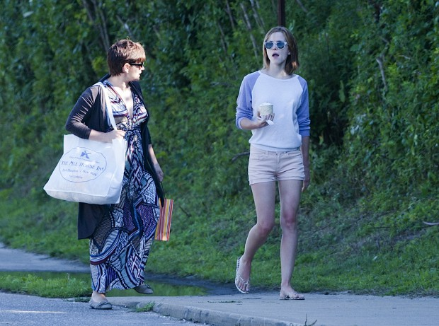 Emma Watson walking along with her mother