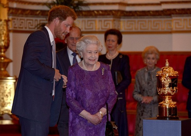 Prince Harry and Queen Elizabeth II in  Buckingham Palace Reception