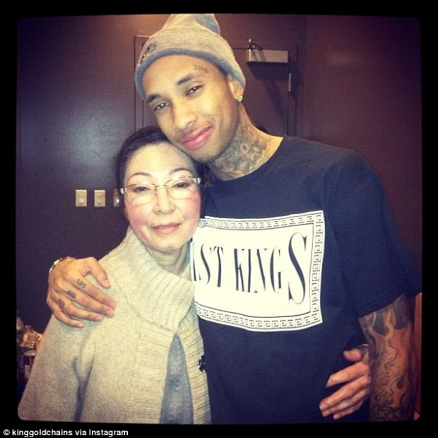 Tyga with his grandma Kim