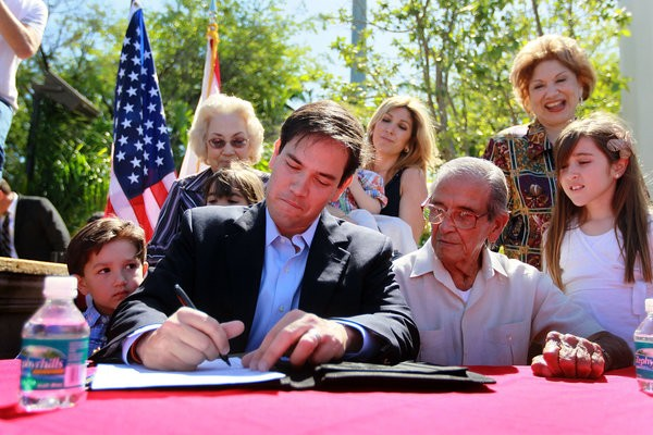 Marco Rubio Family  signed documents in Miami
