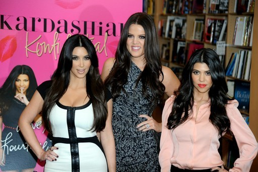 Kim Kardashian, Khloe Kardashian Odom, with Kourtney Kardashian