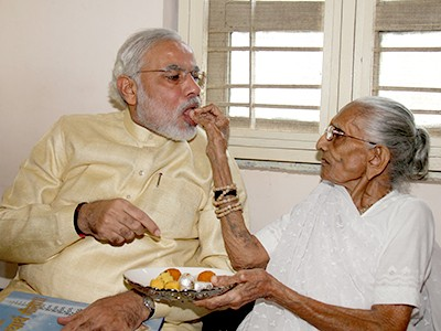 Narendra Modi Mother Putting Sweets After He Becoming Prime Ministe of India