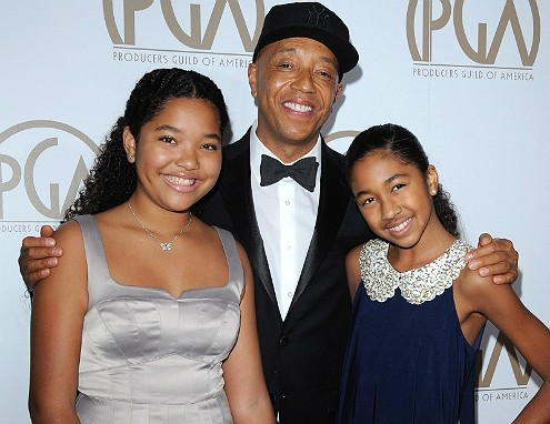 Russell Simmons with his daughters