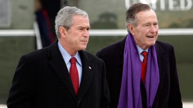 George W. Bush, left, and his father George H.W.