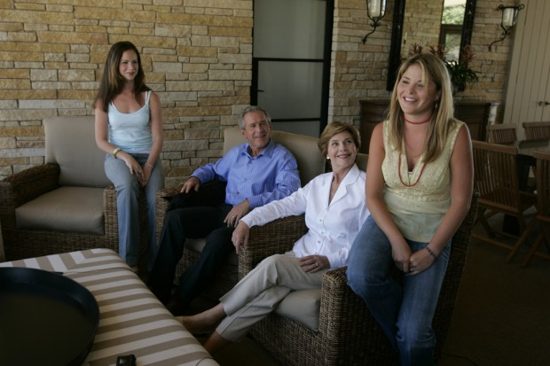 George W. Bush And Mrs. Laura Bush Relax With Their Daughters
