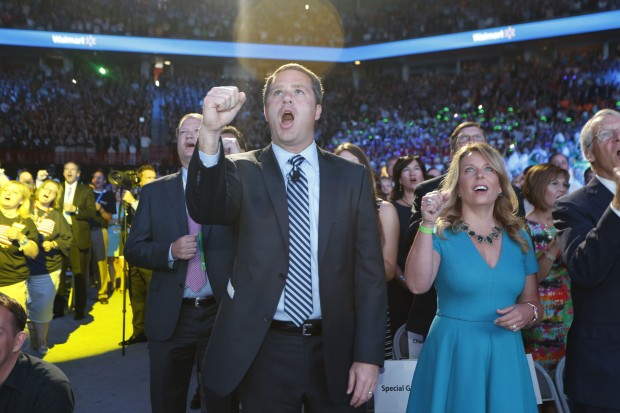 Doug McMillon and His Wife Cheering During a Performance