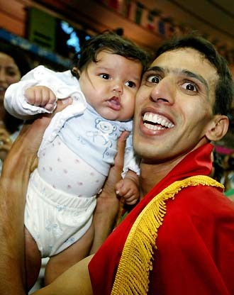 Hicham El Guerrouj with his daughter Hiba