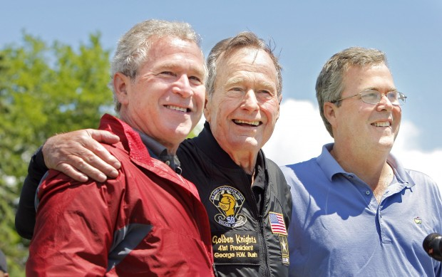 H .W . Bush is flanked by his sons George W. Bush and Jeb Bush