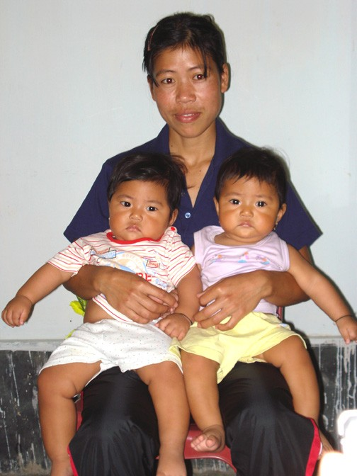 Kom With Her Twin Babies