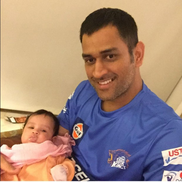 Dhoni with his cute daughter Ziva