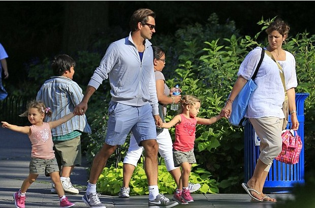 Federer with his wife and daughters