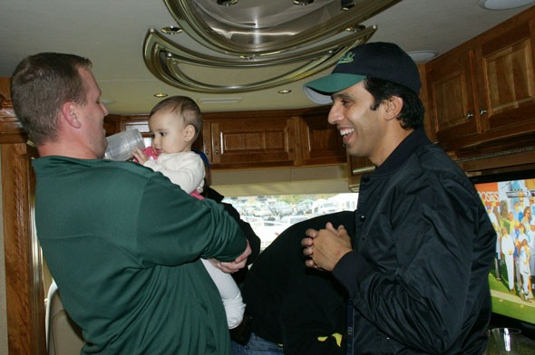 Brandon plays with the Hicham's baby