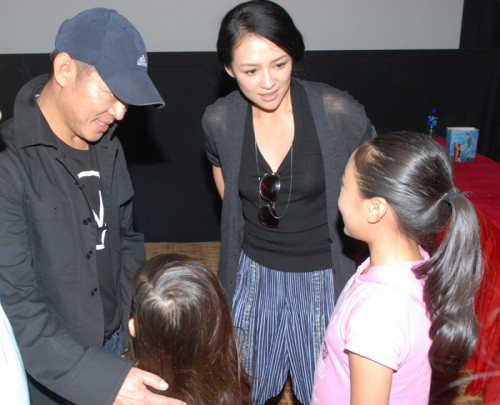 Jet Li and his wife Nina and their daughters Jane and Jada
