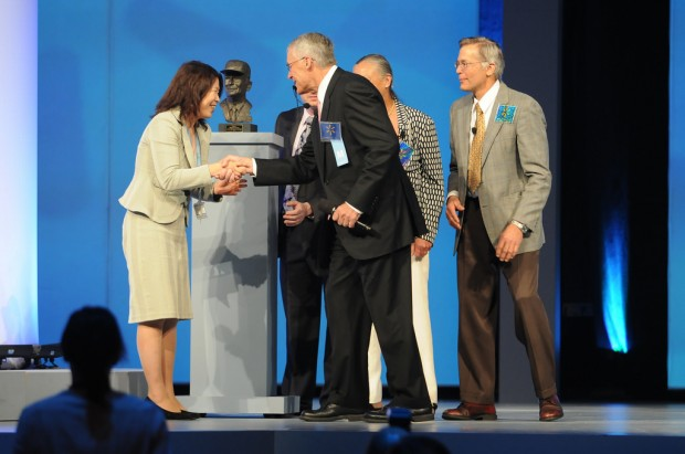 Rob, Alice and Jim Walton presenting Sam Walton Entrepreneur of the year award