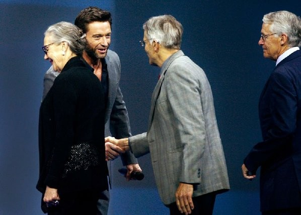 Hollywood Actor Hugh Jackman shaking hands with Jim Walton