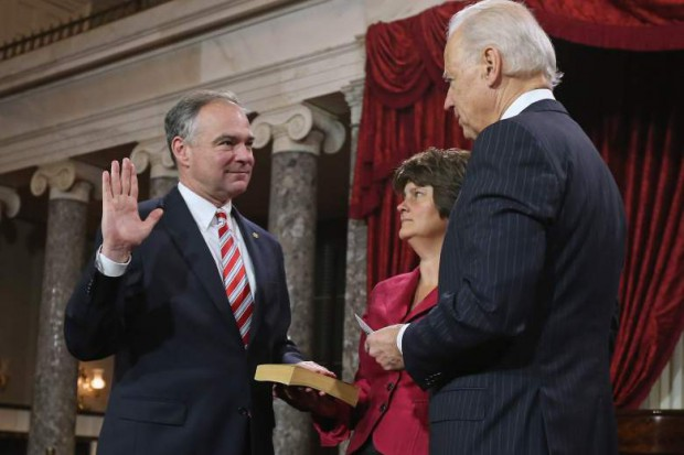 Tim Kaine swearing along with his wife
