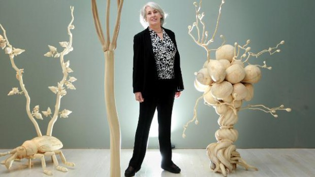 Judith Neilson in her gallery with Cang Xin's Exotic Flowers and Rare Herb series