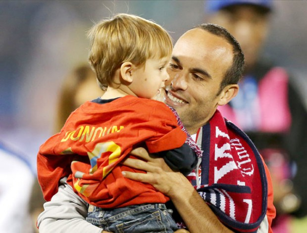 Landon with his son in his final international match