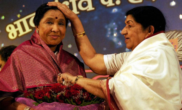 Lata with her sister Asha Bhosle at an event
