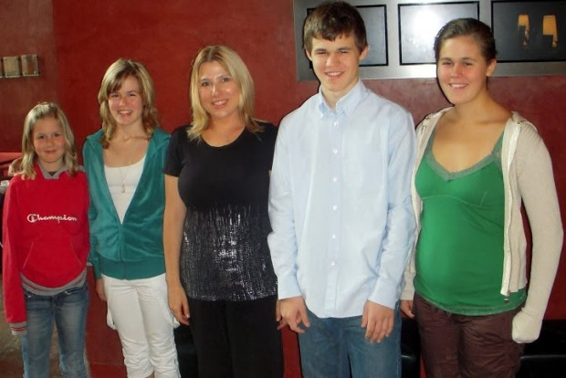 Carlsen with his sisters
