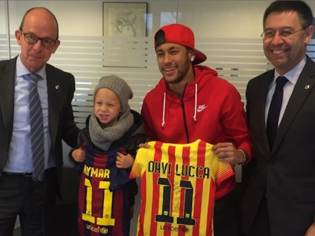 Neymar and his son with Barcelona Jerseys