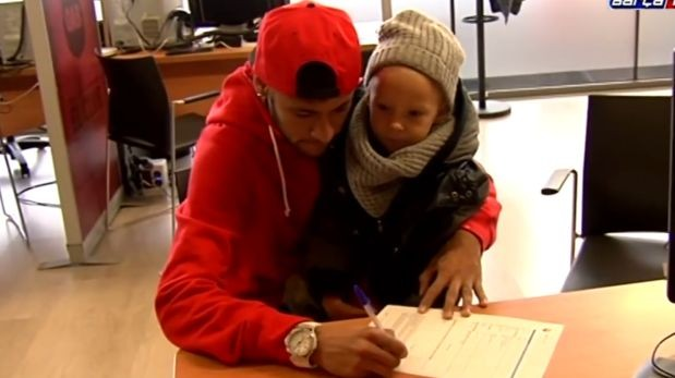 Neymar along with his son signing for Barcelona