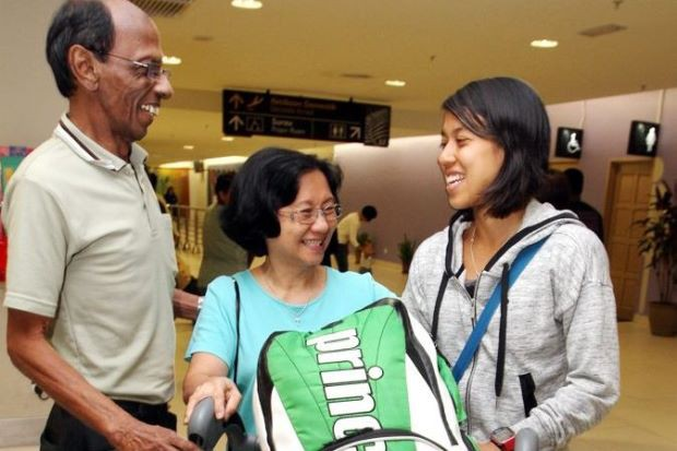 Nicole with her parents at Penang International Airport