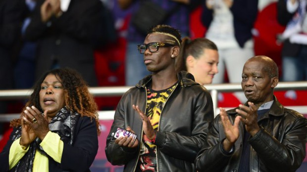 Paul Pogba with his parents