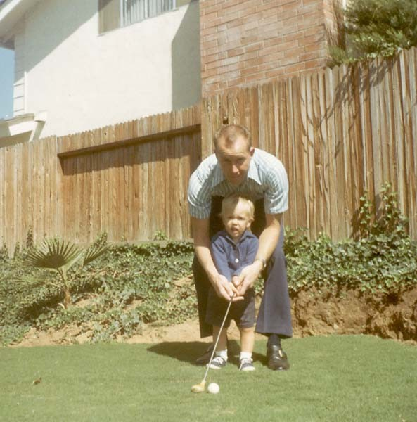 Phil with His Father in his childhood