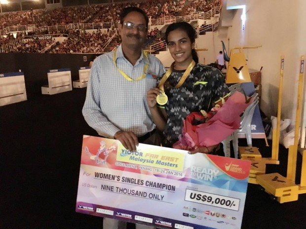 Sindhu with Malaysian Masters medal and prize along with her dad