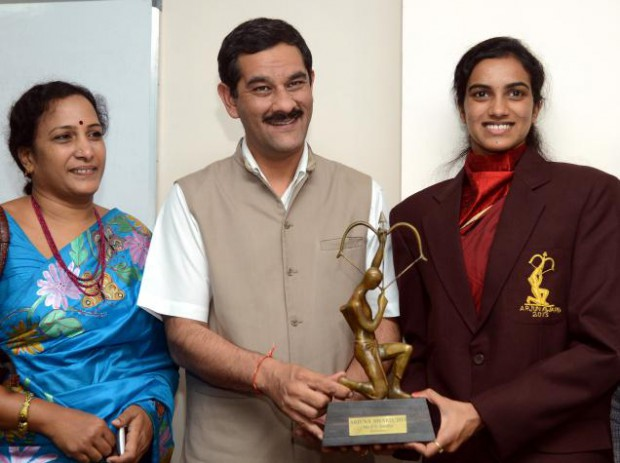 P. Vijaya with her daughter as she receives Arjuna award from Jitendra Singh, Sports Minister