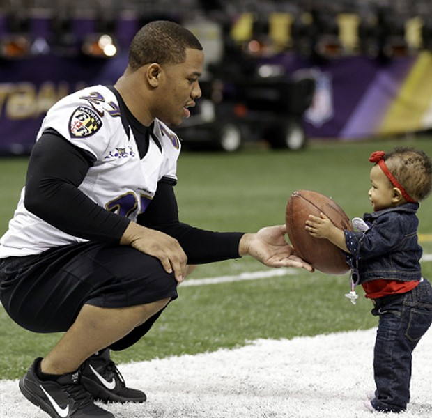 Rayven giving ball to his dad