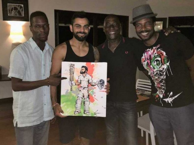 Viv Richard son Mali gifts a painting of kohli to Kohli