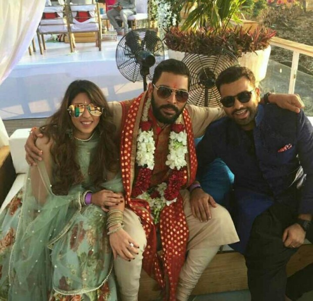 Rohit Sharma and his wife with Yuvraj Singh at Yuvi's wedding cermony