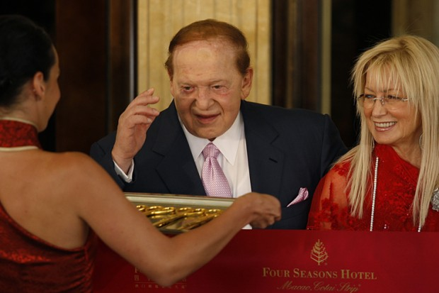 Sheldon Adelson and his wife Miriam attend the ribbon cutting of the Four Seasons Macao hotel