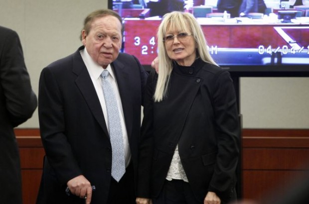 Sheldon Adelson is accompanied by his wife Miriam